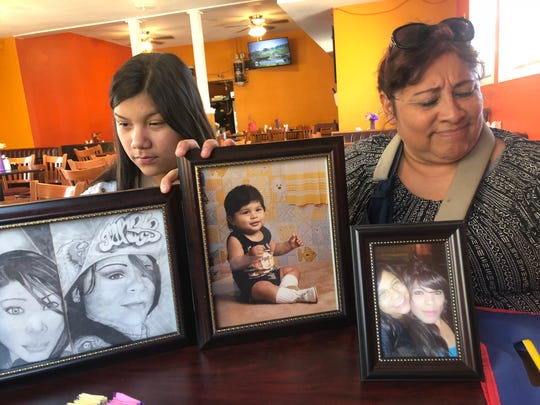 Rosenda Ortiz, left, and Patricia Ortiz, sister and aunt of Laredo shooting victim Nikki Enriquez, display pictures and drawings of Enriquez. She was the last woman to die in the killings.