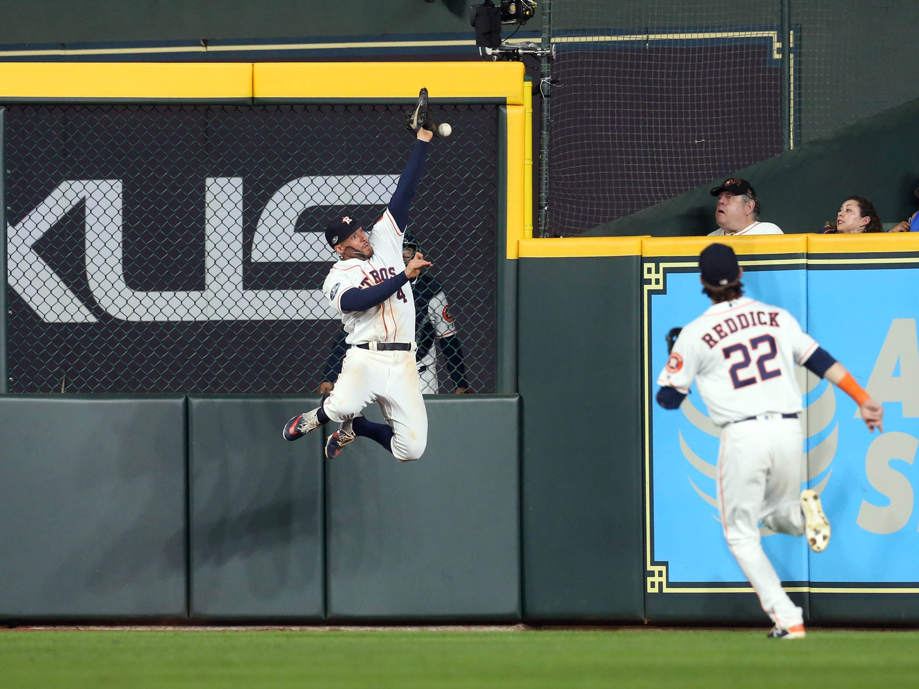 ALCS Game 4: A ball hit by Christian Vazquez is just out of reach for Astros center fielder George Springer in the fourth inning.