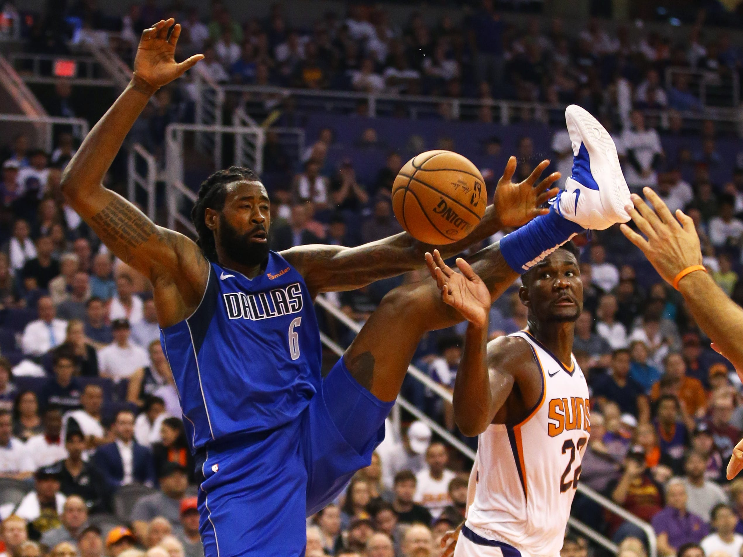 Oct. 17: Dallas Mavericks center DeAndre Jordan (6) battles for a rebound against Phoenix Suns center Deandre Ayton (22) in the second half at Talking Stick Resort Arena.
