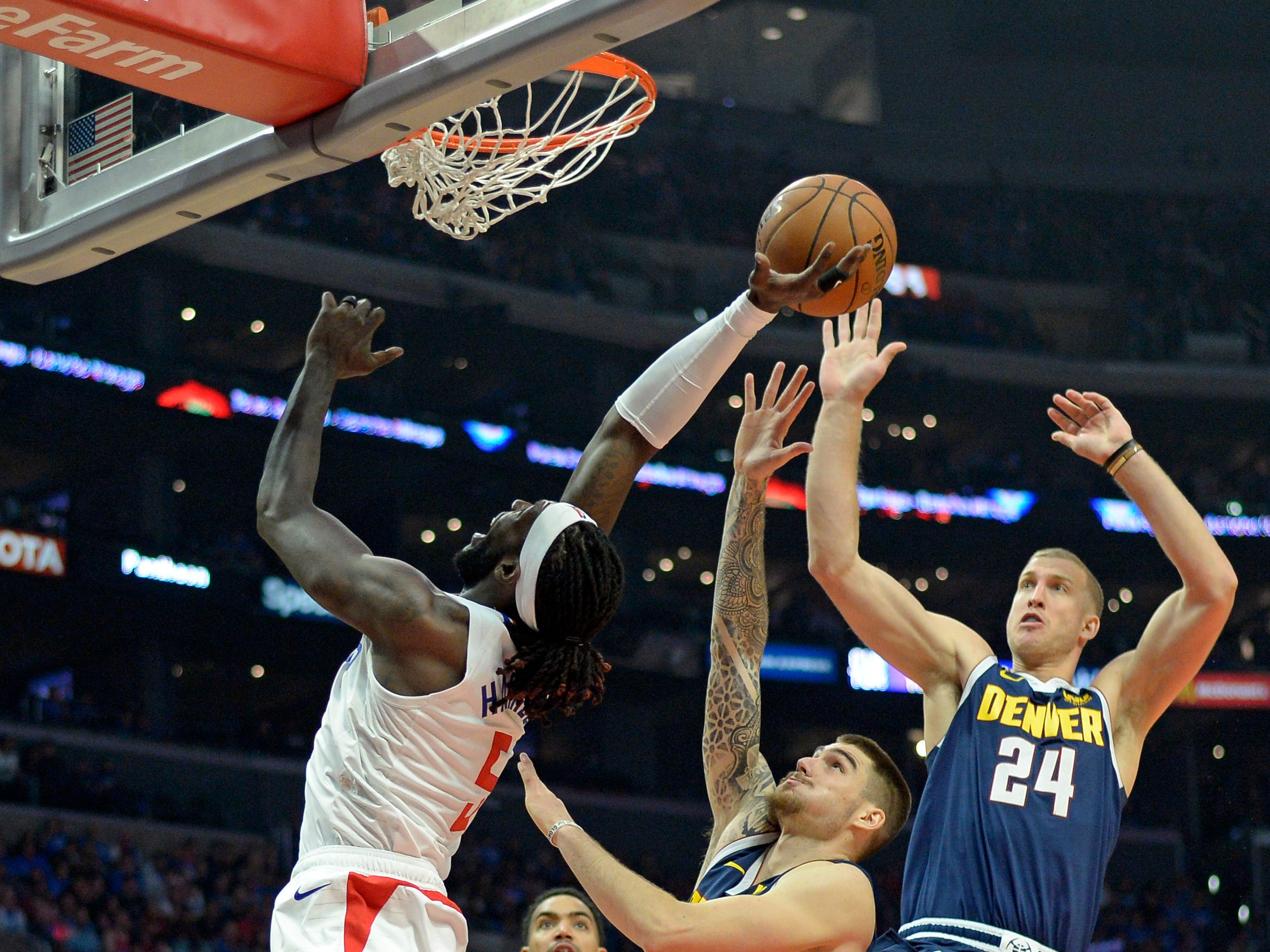 Oct. 17: LA Clippers forward Montrezl Harrell shoots against Denver Nuggets forward Juan Hernangomez (41) and forward Mason Plumlee (24) during the fourth quarter at Staples Center.