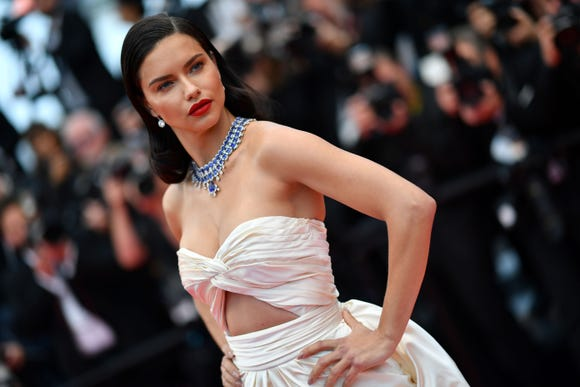 """Adriana Lima poses as she arrives on May 16, 2018 for the screening of the film """"Burning"""" at the 71st edition of the Cannes Film Festival in Cannes, southern France."""