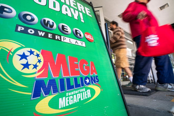 An advertisement for Mega Millions, a 44-state lottery with a jackpot of nearly one billion US dollars, outside a grocery store in Washington, Oct. 18,  2018. Friday's Mega Millions drawing will be the second largest lottery jackpot in US history.