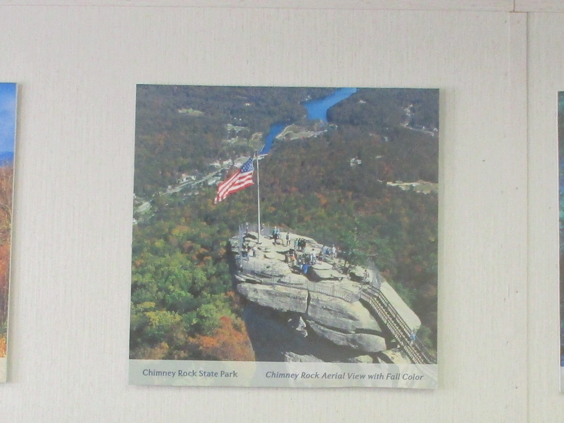 Walls in the call center are hung with photos showing some of North Carolina's major tourist attractions.