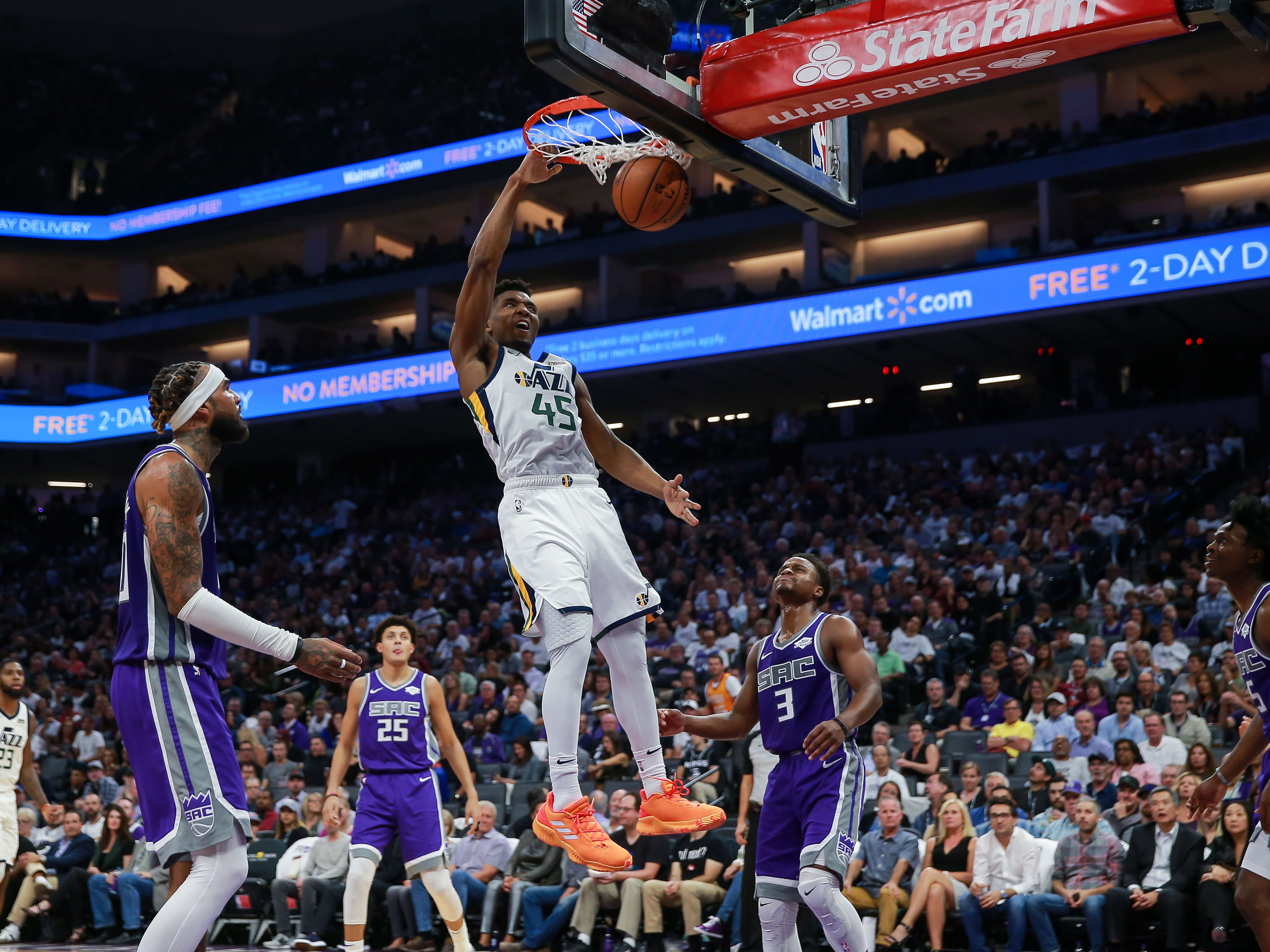 Oct. 17: Utah Jazz guard Donovan Mitchell dunks the ball against the Sacramento Kings during the fourth quarter at Golden 1 Center.