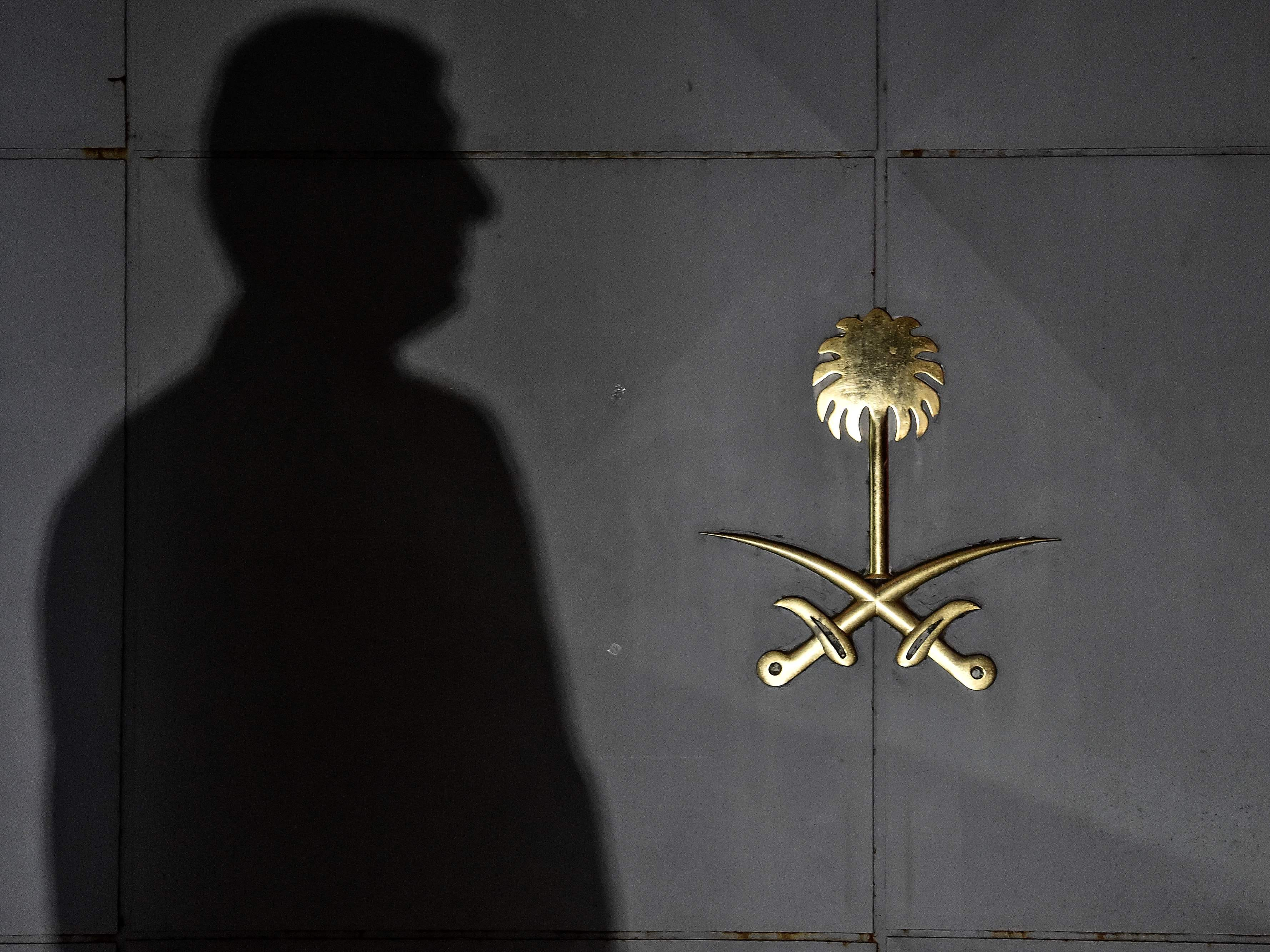 Security members of the consulate wait in front of the gate door of the Saudi Arabian consulate, Oct. 17, 2018, in Istanbul.
