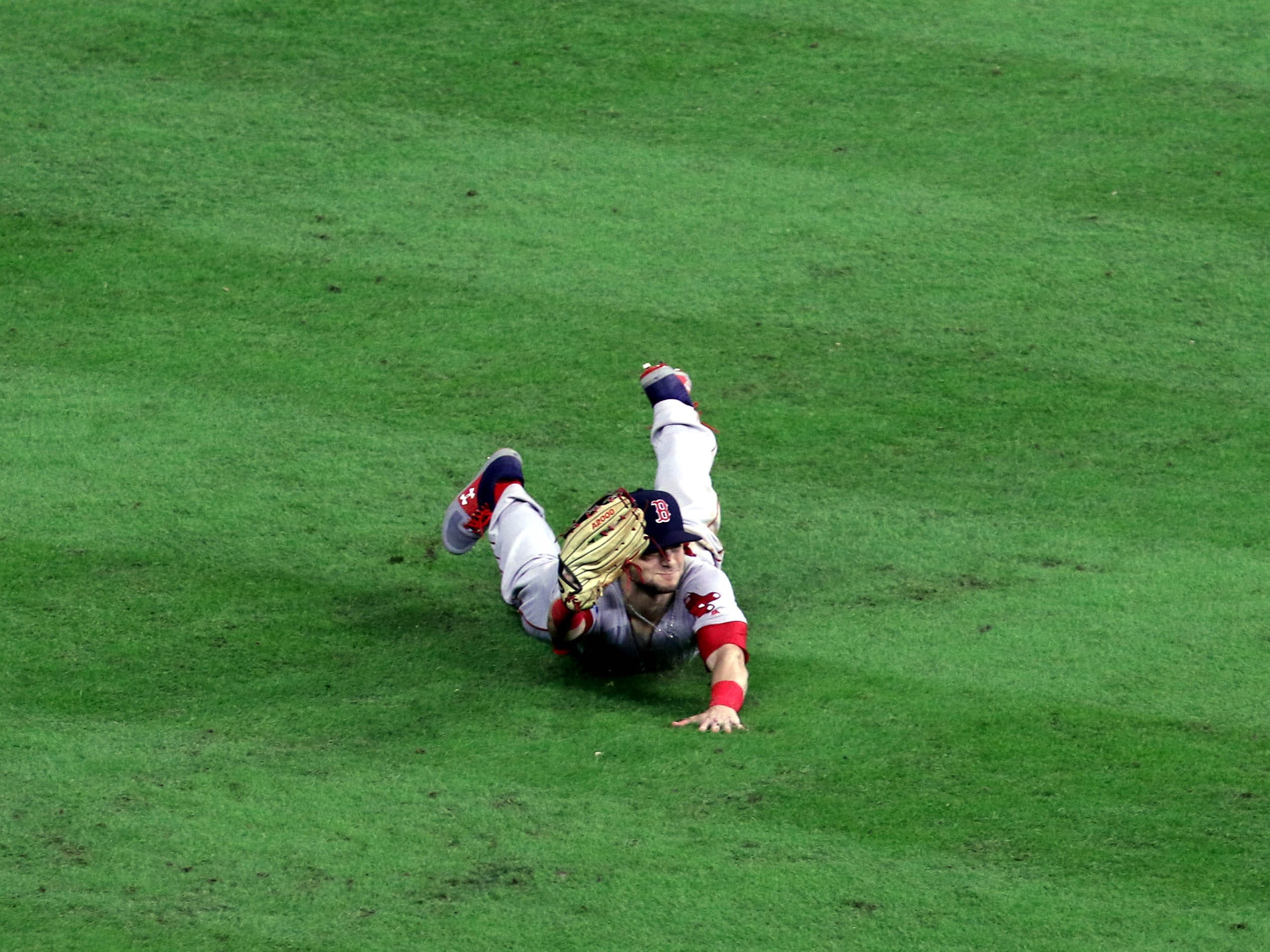 ALCS Game 4: Red Sox left fielder Andrew Benintendi makes a game-ending diving catch in the ninth inning to secure the win.