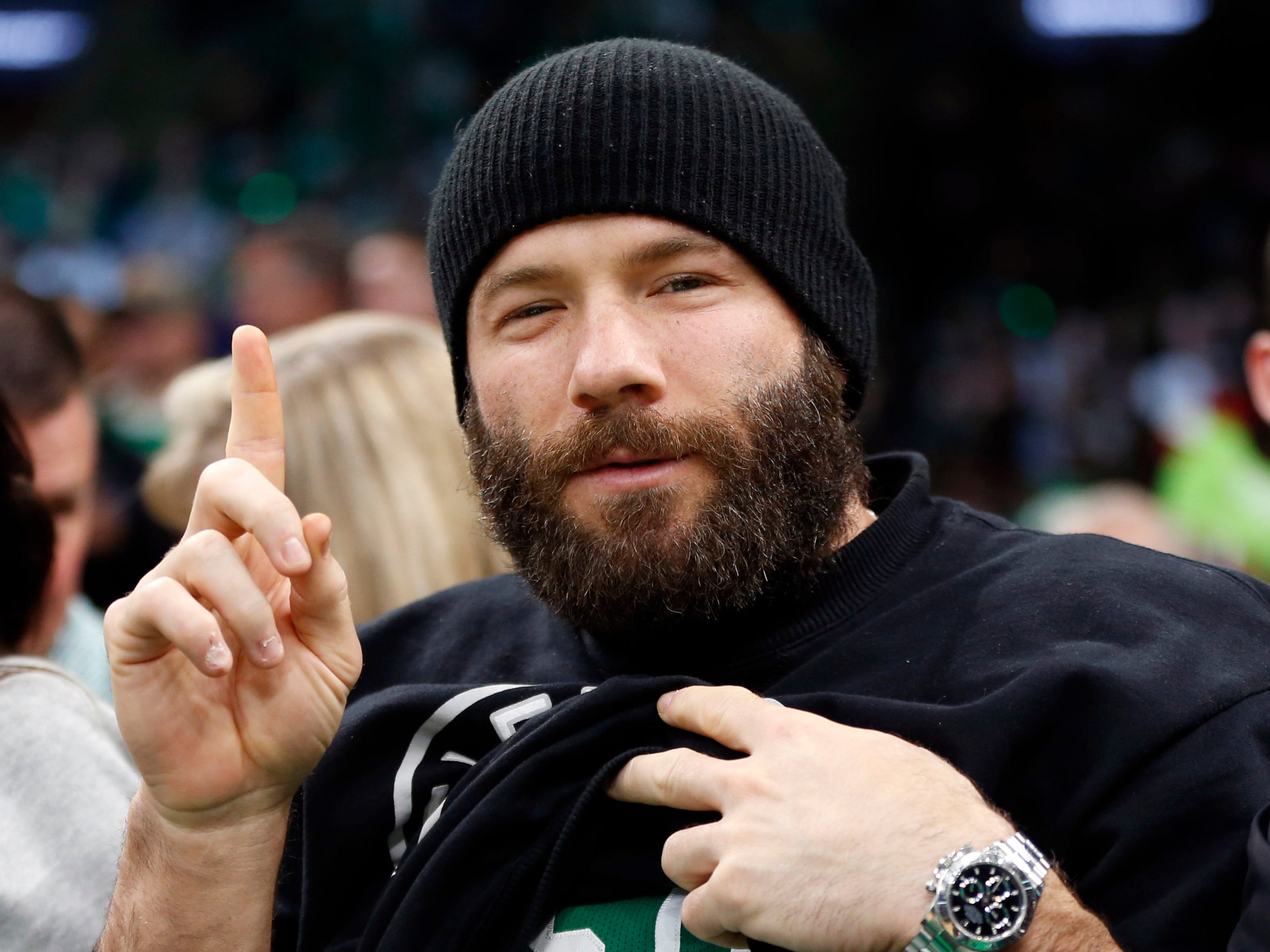 Oct. 16: Julian Edelman shows off his Kyrie Irving jersey during the second half against the Philadelphia 76ers at TD Garden.