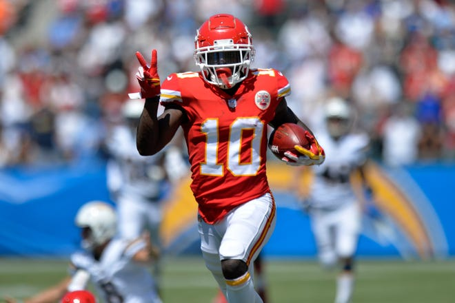 Kansas City Chiefs wide receiver Tyreek Hill (10) runs a punt back for a touchdown  against the Los Angeles Chargers at StubHub Center.