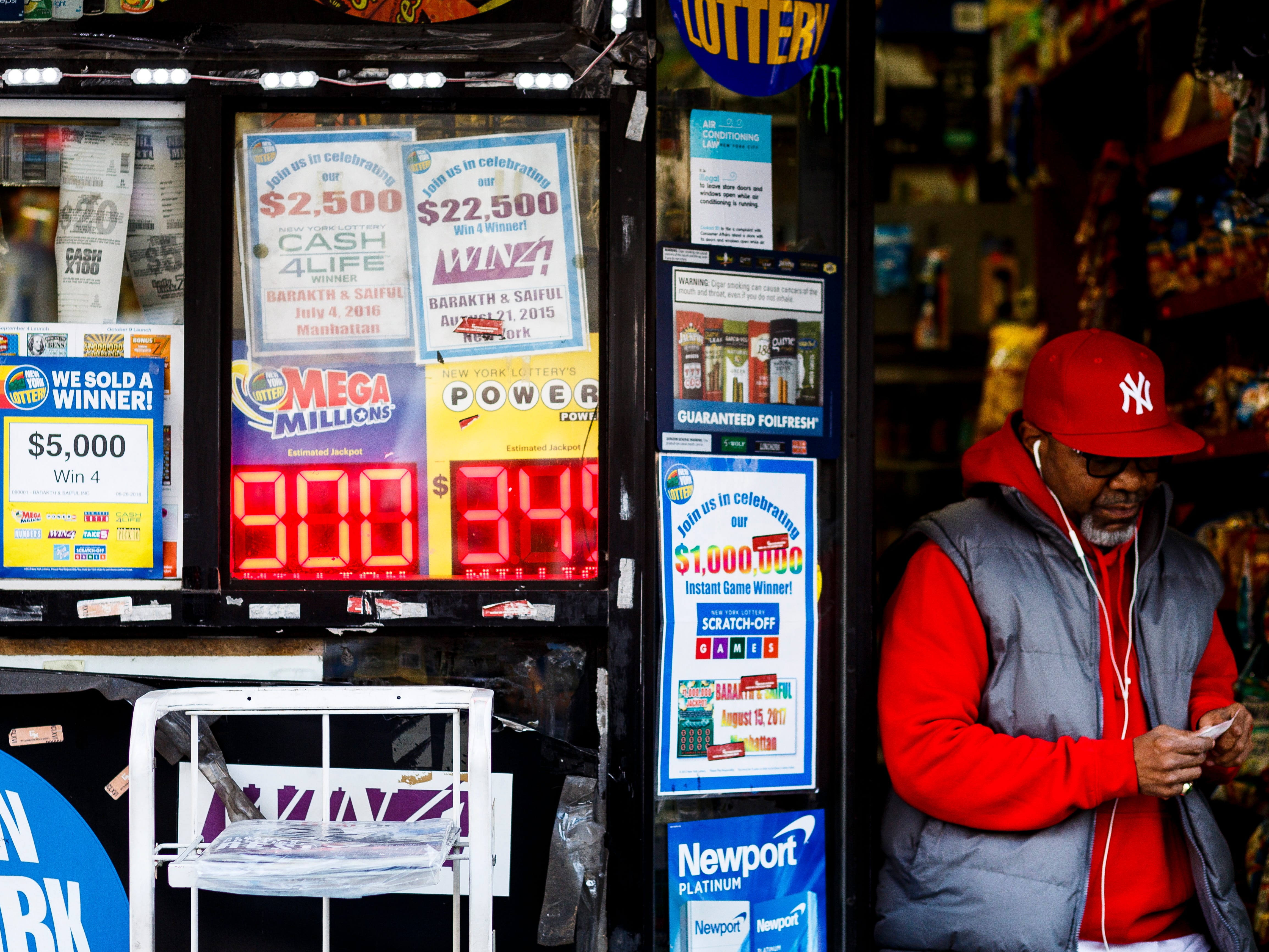 A view of a sign showing the jackpot for the Mega Millions lottery at $900 million in New York, Oct. 17, 2018.