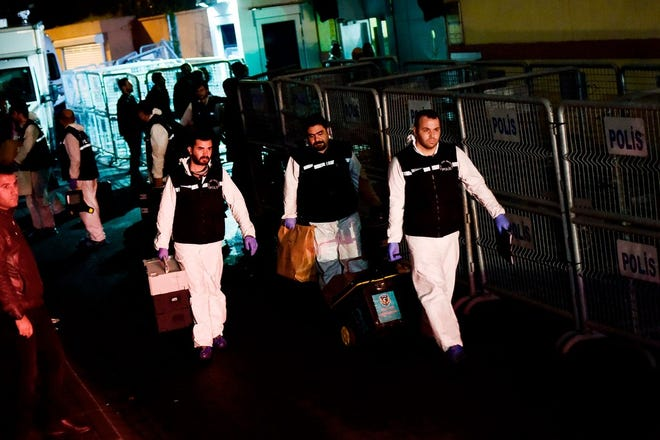Turkish forensic police officers leave after searching for evidence related to the disappearance of Jamal Khashoggi at Saudi Arabia's consulate in Istanbul on October 18.