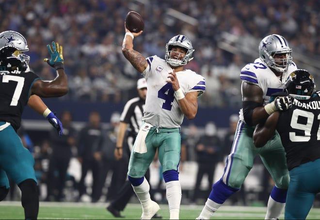 Dallas Cowboys quarterback Dak Prescott (4) throws in the pocket in the third quarter against the Jacksonville Jaguars at AT&T Stadium.