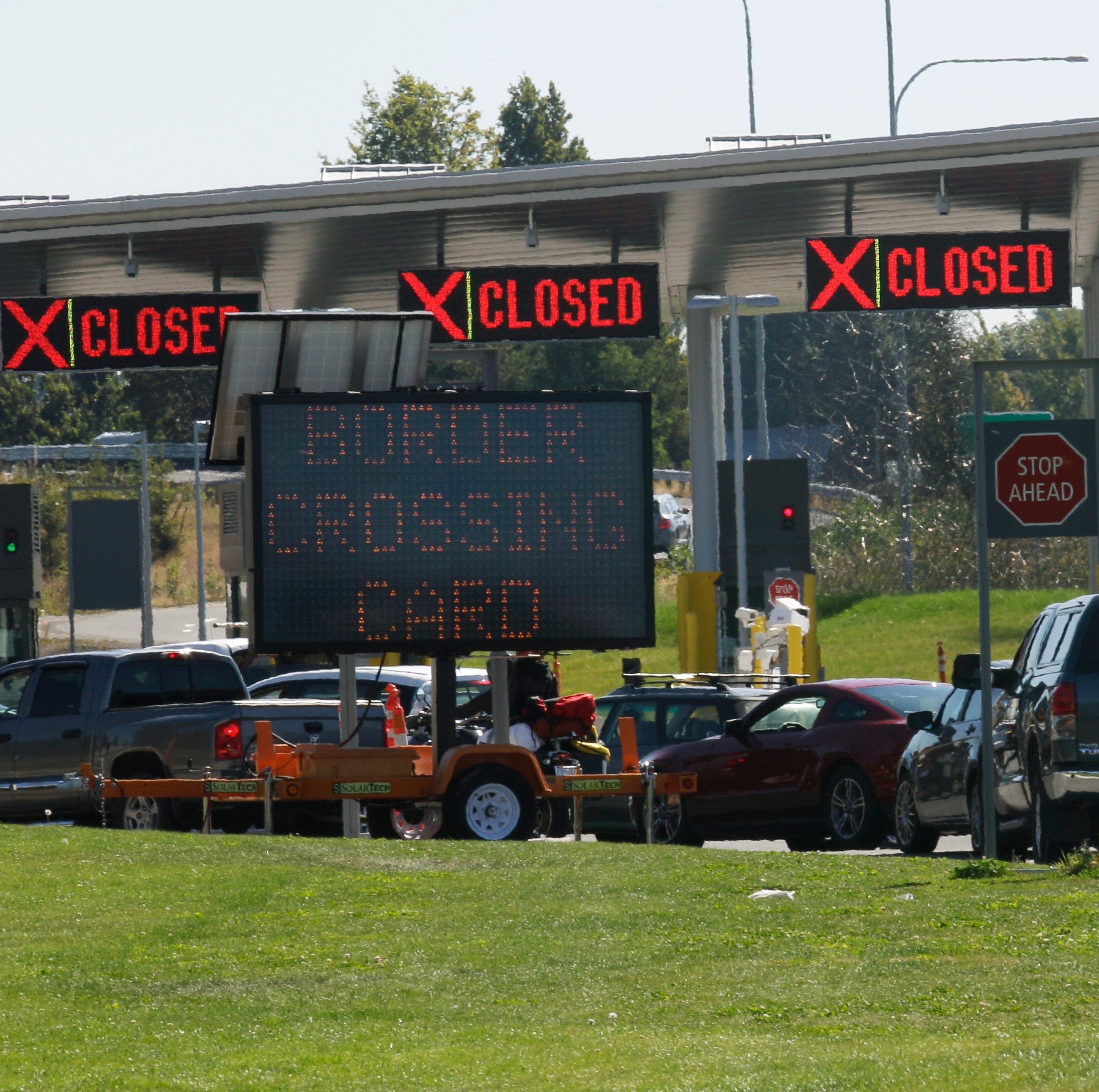 Cars waiting to enter the United States from Canada, line up at a border checkpoint, Wednesday, Sept. 7, 2011, near Blaine, Wash. The increased focus on border security since the Sept. 11, 2001 terrorist attacks has led to tensions between the government and local residents in the area.