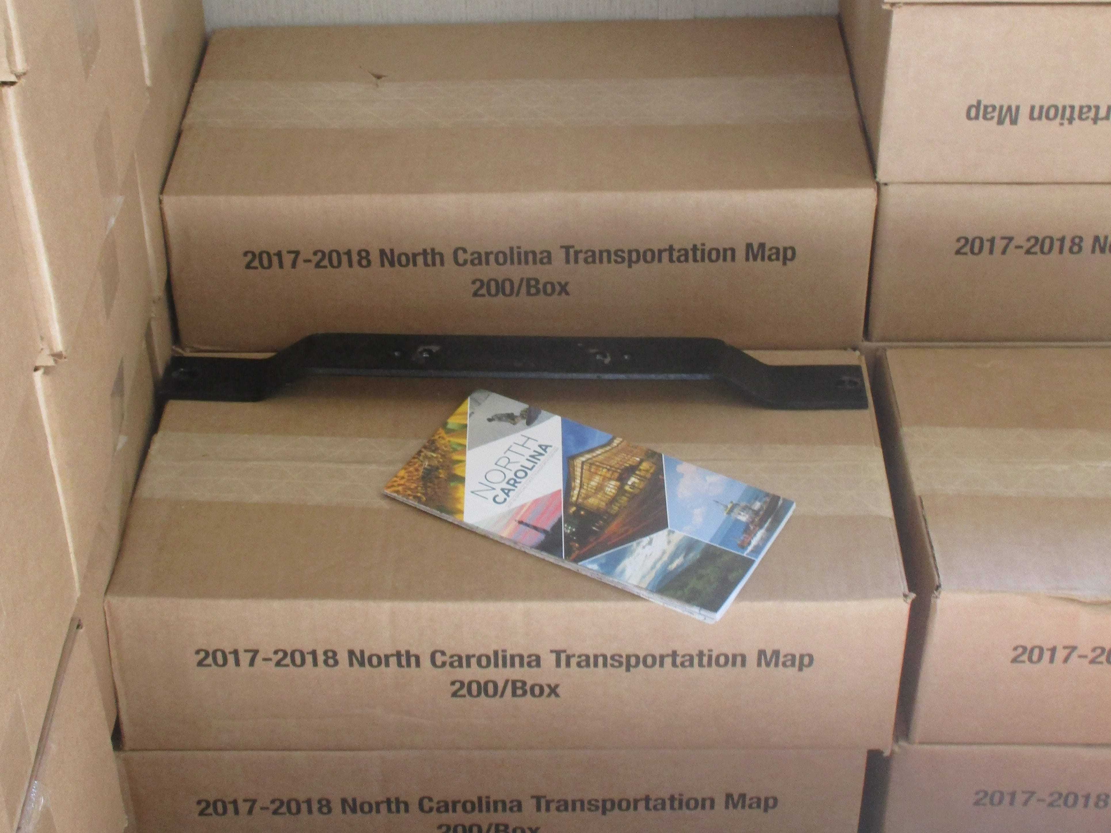 Boxes of maps and brochures are ready for shipment.