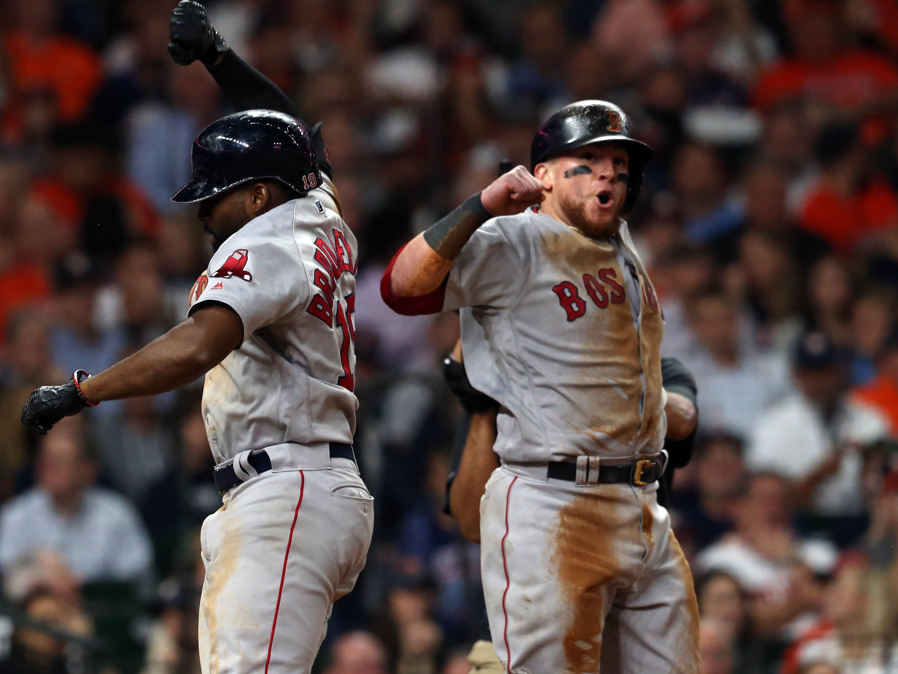 ALCS Game 4: Red Sox center fielder Jackie Bradley Jr. catcher Christian Vazquez celebrate after Bradley's two-run home run in the sixth inning.