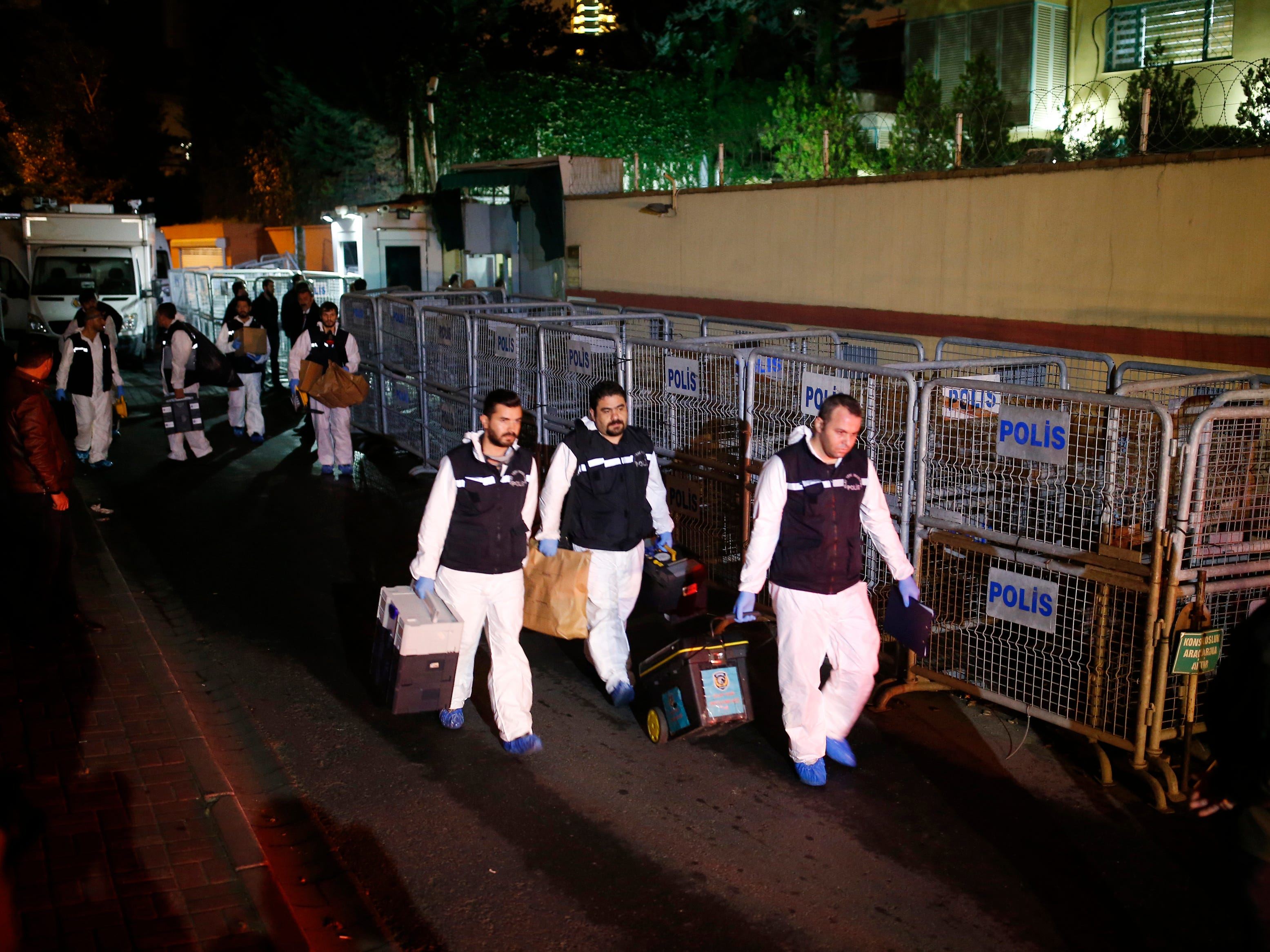 Turkish forensic officers leave the Saudi consulate after they conducted a new search over the disappearance and alleged slaying of writer Jamal Khashoggi, in Istanbul, early Thursday, Oct. 18, 2018.