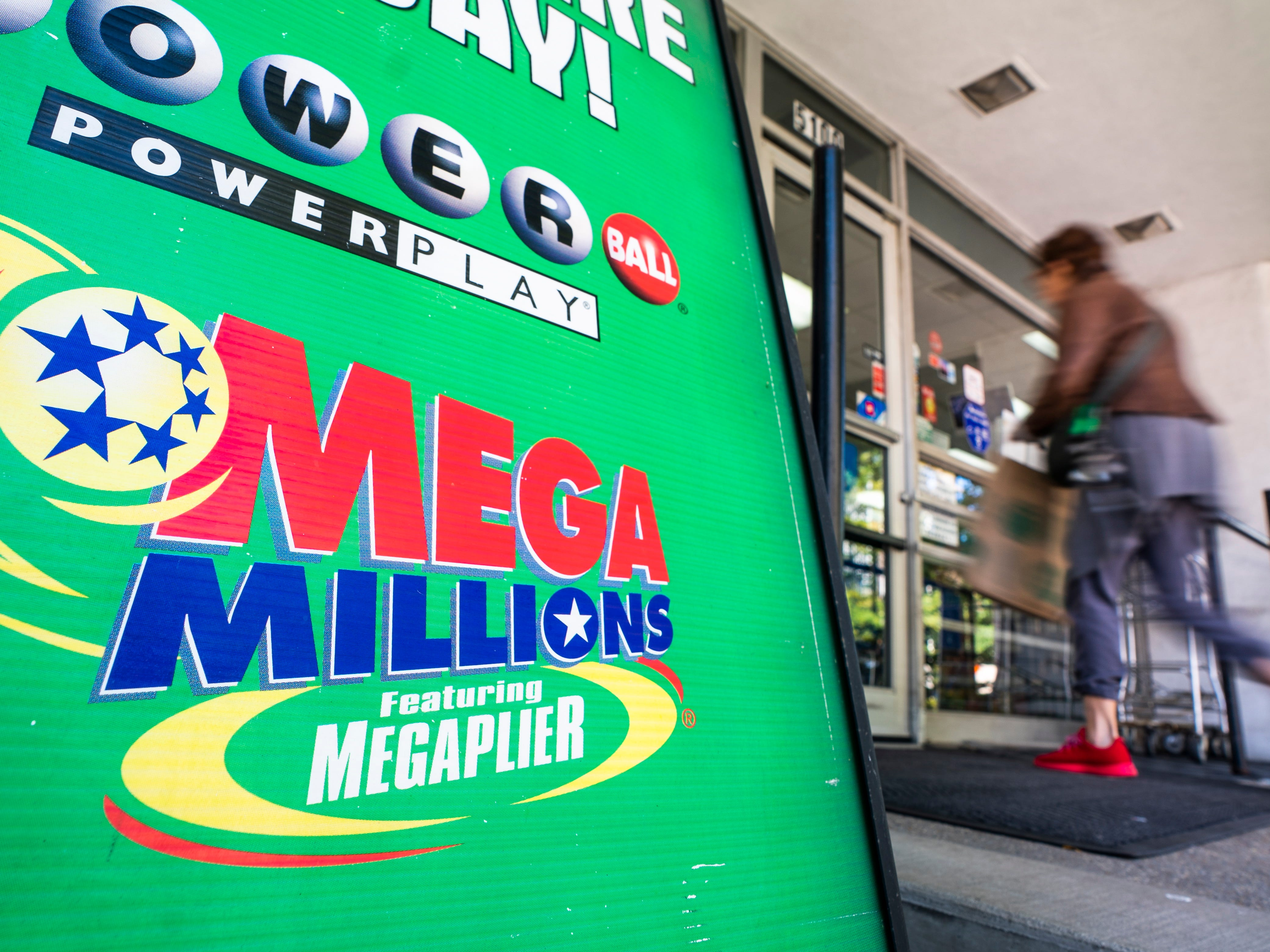 An advertisement for Mega Millions, a 44-state lottery with a record jackpot of nearly one billion dollars, outside a grocery store in Washington, D.C., Oct. 18, 2018.