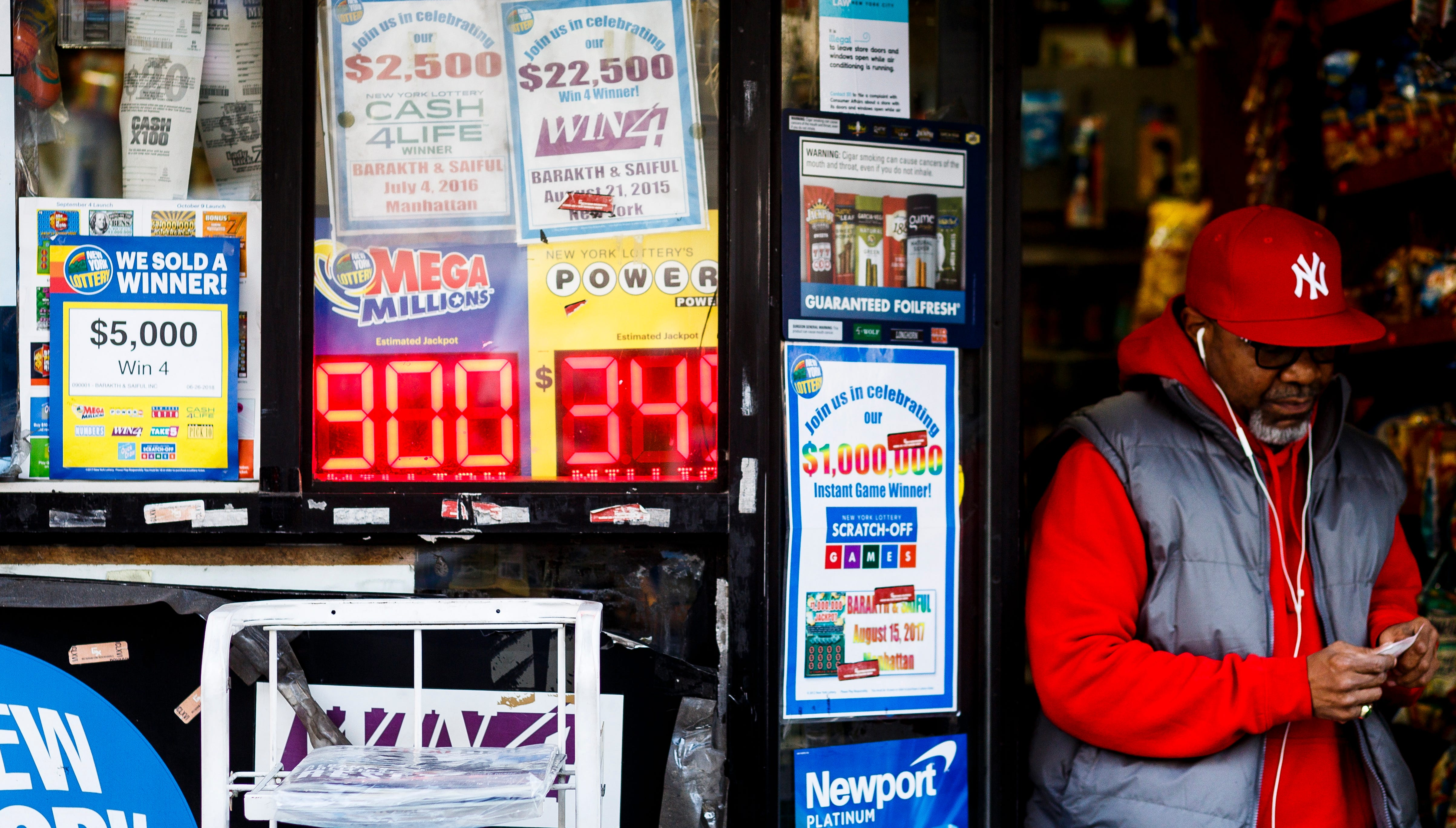 A view of a sign showing the jackpot for the Mega Millions lottery at $900 million in New York, New York, on October 17, 2018.