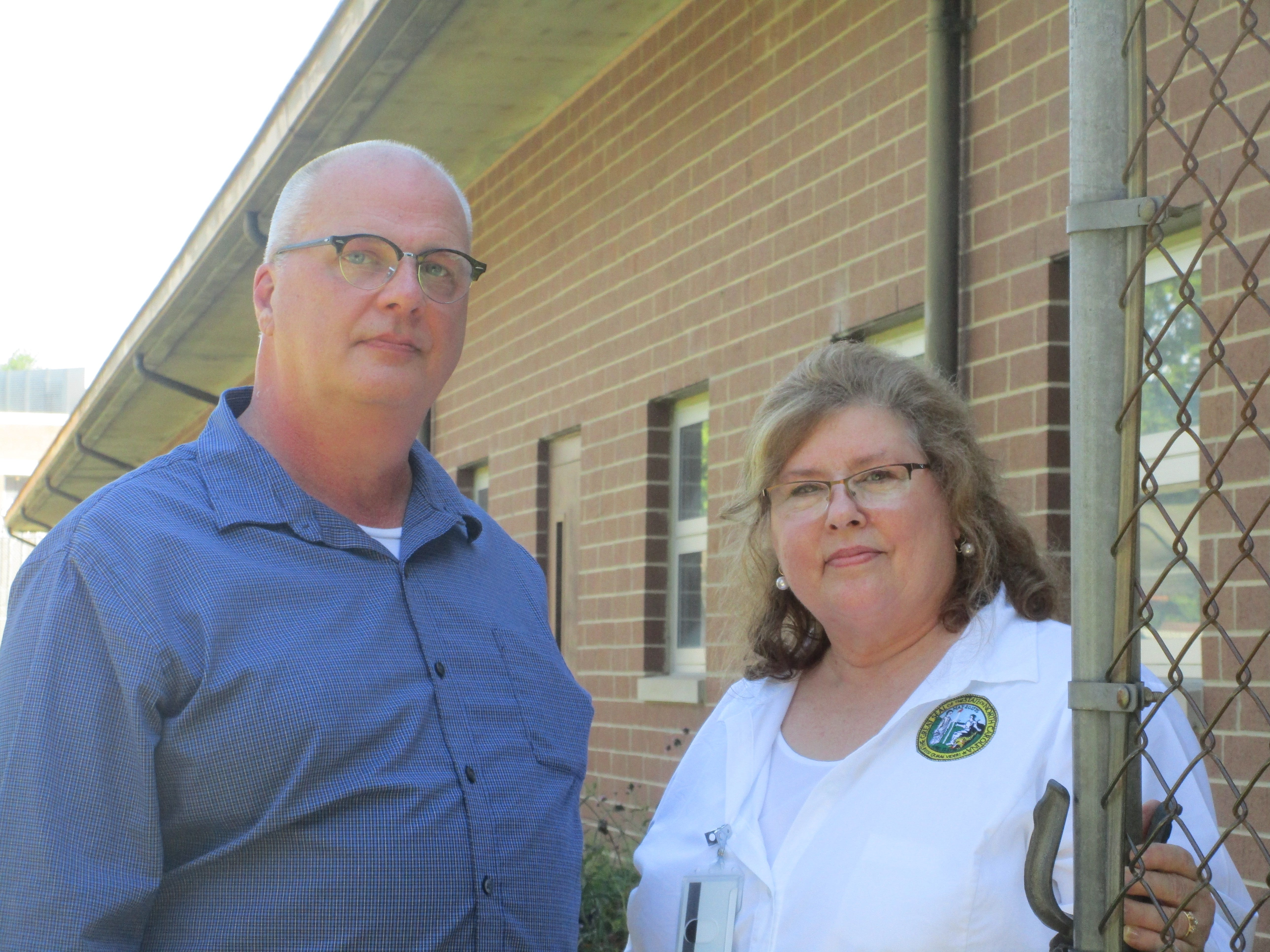 "The program began in the 1980s, according to Bryan Gupton, of the N.C. Department of Commerce, left, and Teresa Smith, the call center's onsite supervisor for the Department of Commerce. ""The program is a model of efficiency of the state government,"" Gupton says. ""And we understand that participating inmates make a significant contribution to our economy."""
