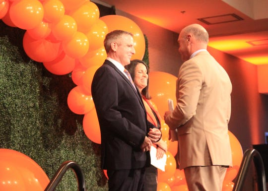 Clemson president Jim Clements thanks Cheri and Ben Phyfer for their $2.5 million gift to the university.