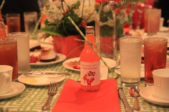 Orange sodas decked the tables at lunch to celebrate a $2.5 million gift from trustee Cheri Phyfer and her husband, Ben. The sodas had their daughters' names, Dani and Ali.