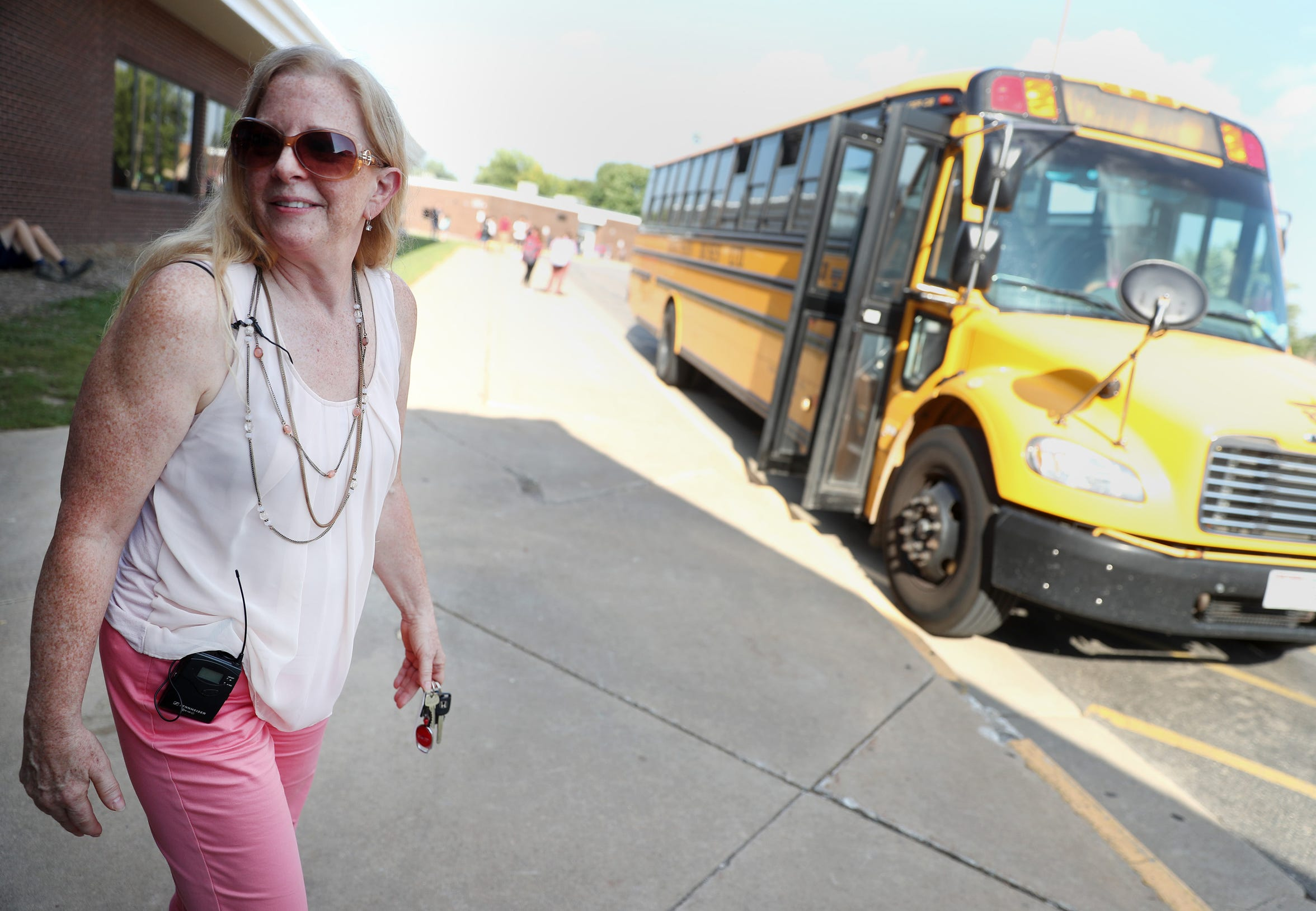 Maripat Franke, a special education teacher at Neenah High School currently enrolled in the Residency In Teacher Education 2.0 program at CESA 6, stands outside Neenah High School while working bus duty at the end of the day on Sept. 17, 2018, in Neenah, Wis. Danny Damiani/USA TODAY NETWORK-Wisconsin