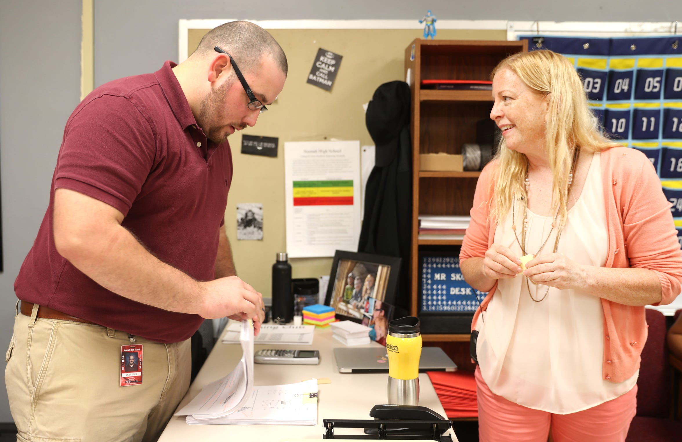 Chris Skogen, a math teacher at Neenah High School, prepares a stack of tests with Maripat Franke, a special education teacher currently enrolled in the Residency In Teacher Education 2.0 program at CESA 6, on Sept. 17, 2018, in Neenah, Wis. Skogen and Franke co-teach the class. Danny Damiani/USA TODAY NETWORK-Wisconsin