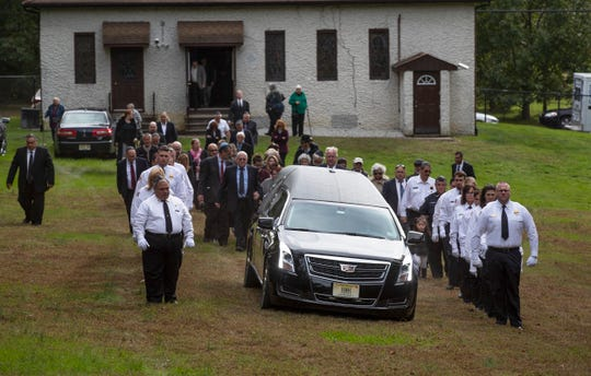 The Freehold First Aid Squad acted as an honor guard at the funeral of Jerry Wolkowitz. Family and friends mourn for Jerry Wolkowitz, who police said was attacked and left in a coma for six months before succumbing to his injuries. Wolkowitz worked as and EMT and a freelance photographer.