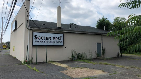 An addition to the former Soccer Post store will create a center with two restaurants.