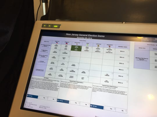 Union County approved a $1.9 million contract for new touchscreen voting machines that print out a paper ballot.