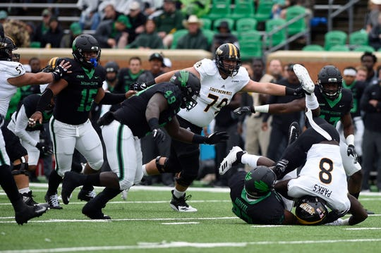 North Texas defensive lineman Dion Novil (97) takes down Southern Miss running back Tez Parks (8) at Apogee Stadium in Denton on Saturday, Oct. 13, 2018.
