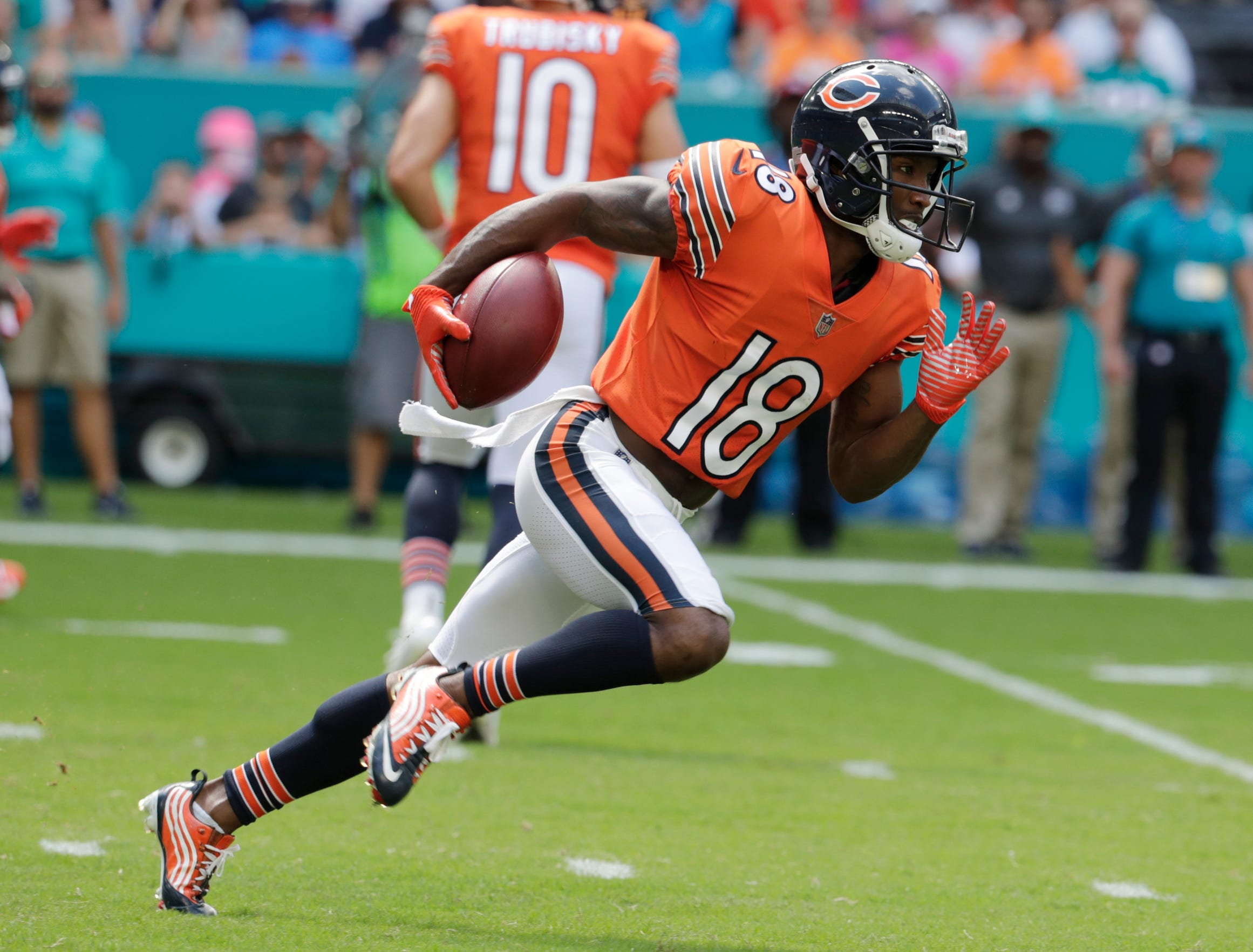 Chicago Bears wide receiver Taylor Gabriel (18) carries the ball during the first half against the Miami Dolphins, Sunday, Oct. 14, 2018, in Miami Gardens, Fla.