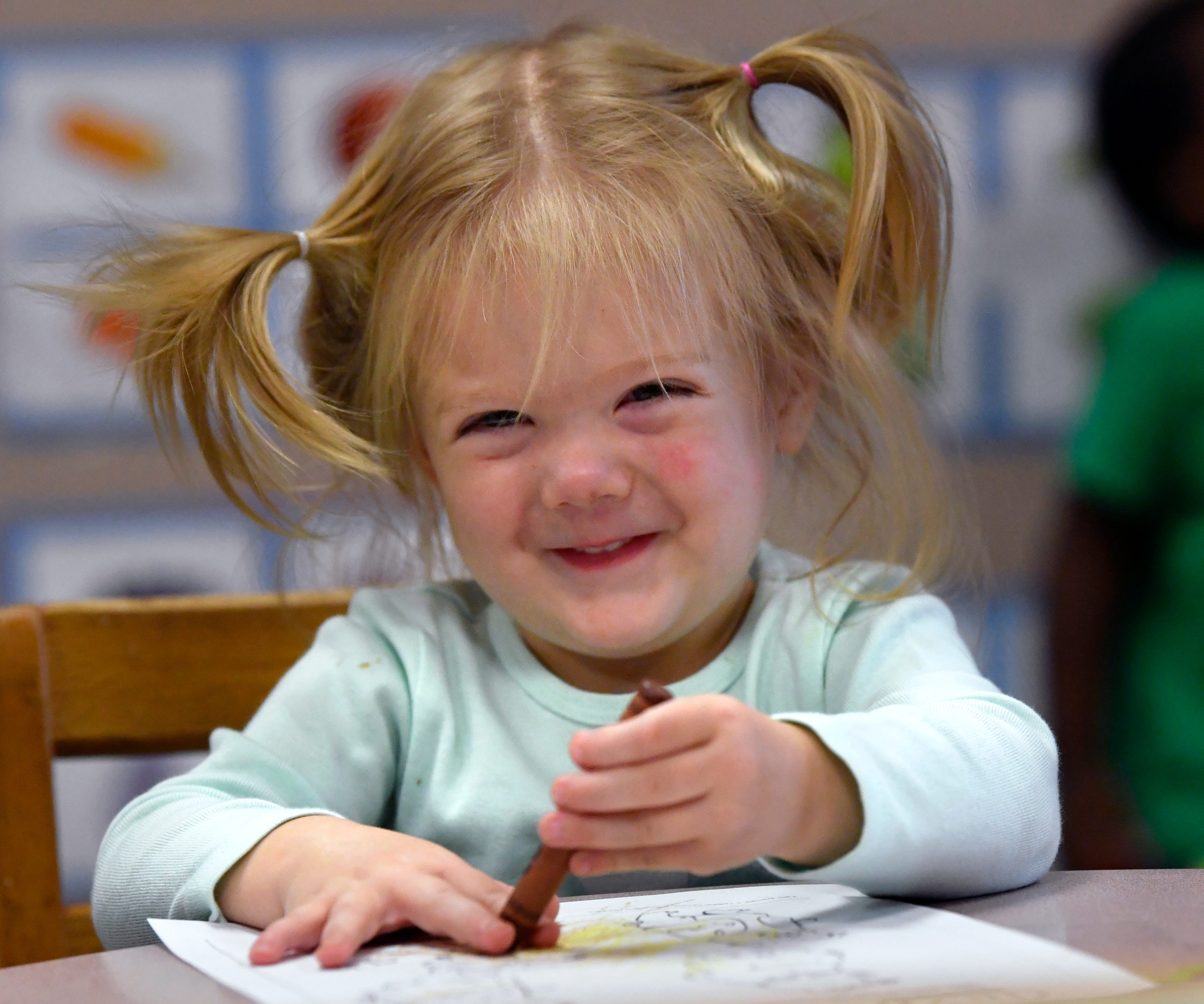 Allison Morris smiles while playing with friends Friday at the Day Nursery of Abilene Cedar Street Center. Nearly 6,000 children have attended the day care facility since it opened in 1993.