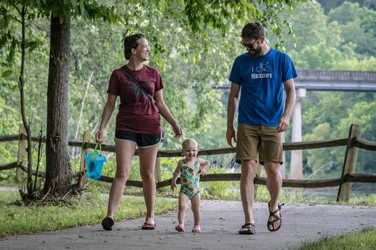 A young family walks along a path at Riverside Park in Woodfin. A major project underway in this northern Buncombe County town will eventually include five miles of greenway, new parks, a Whitewater Wave and new river access.