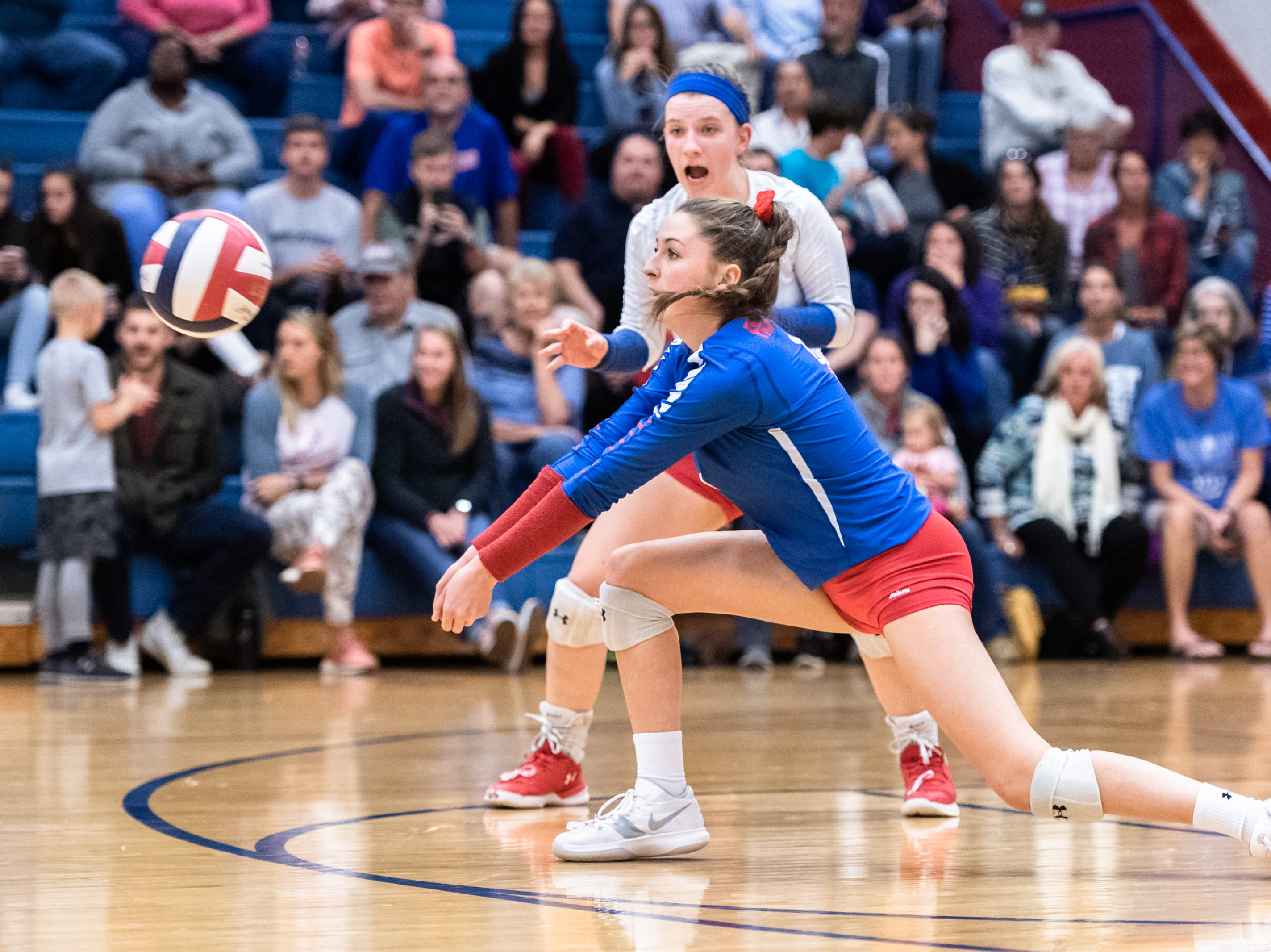 West Henderson's Bailey Lance returns a shot to Reynolds during their WMAC tournament championship volleyball game Oct. 18, 2018.