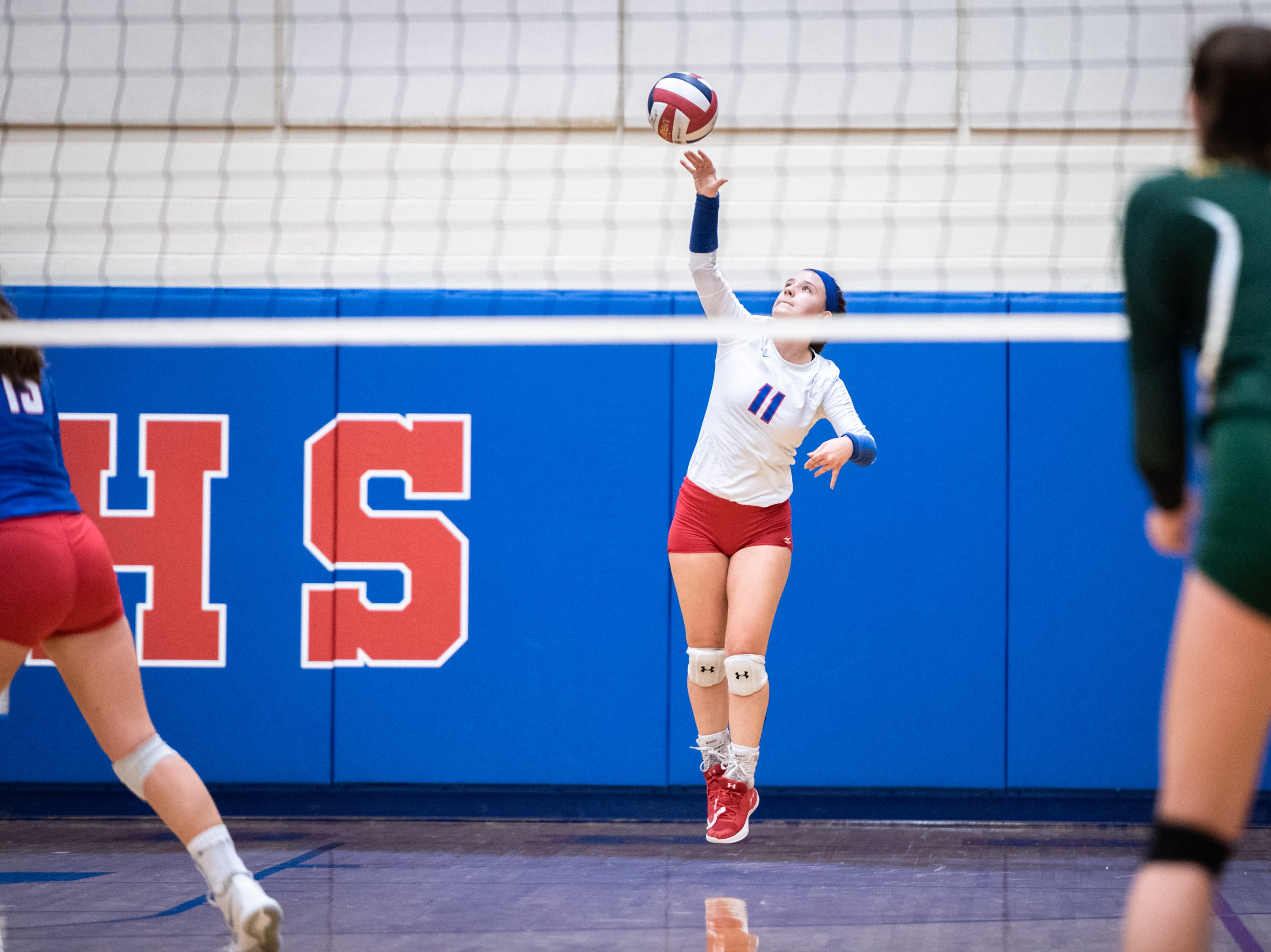 West Henderson's Ashley Downer serves to Reynolds in their WMAC tournament championship volleyball game Oct. 18, 2018.
