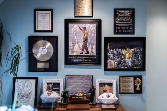 A wall in the home of Kelly Gentry and David Gentry, head coach of the Murphy high school football team, with various awards and accolades.