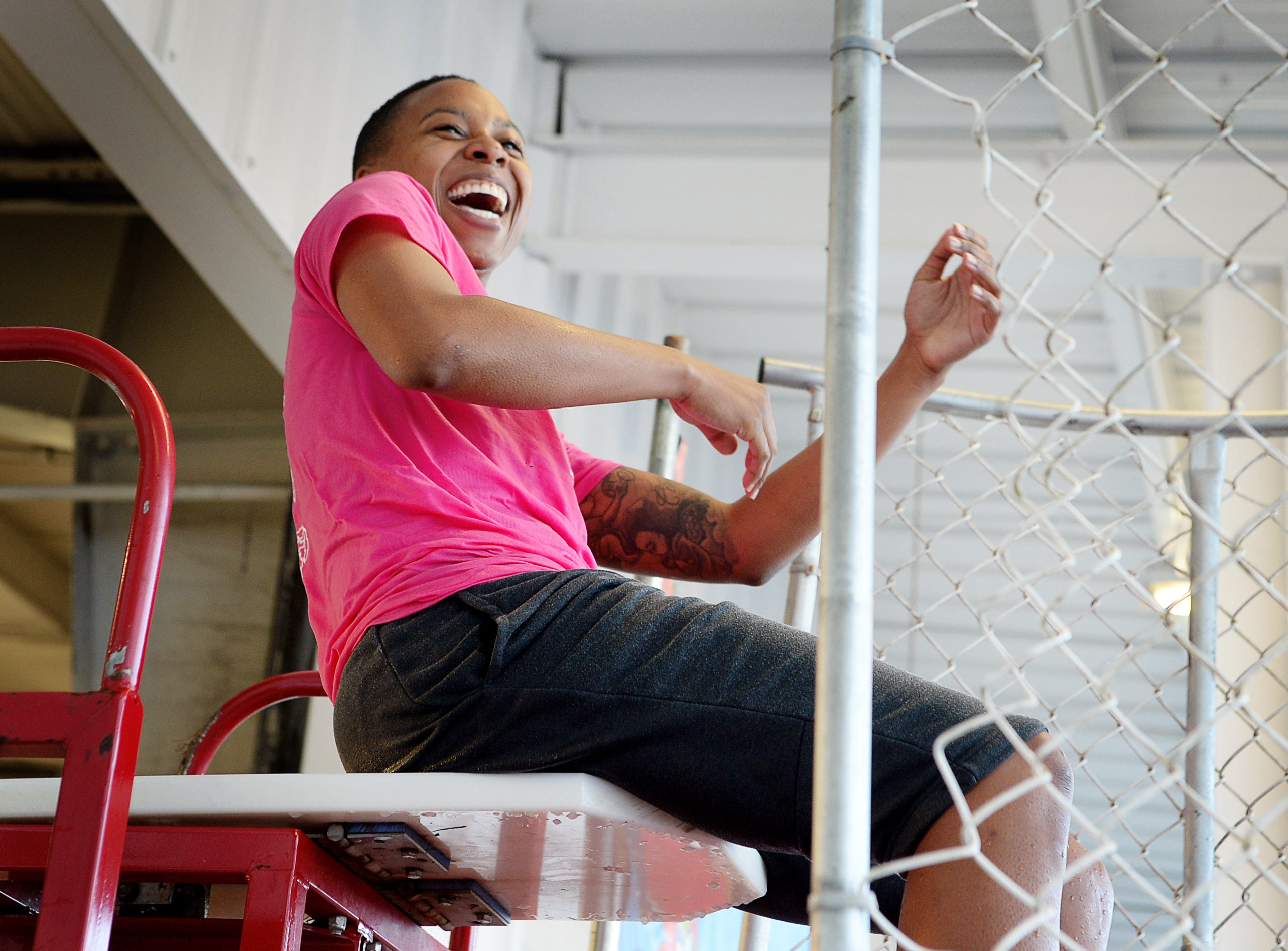 Lauren Allen laughs as people test their aim at the dunk tank at the #IDrive4 breast cancer fundraiser benefitting The Hope Chest for Women at Asheville Chevrolet Oct. 18, 2018. During the month of October, the dealership is donating $5 for every #AshevilleChevyDrives4 hashtag on Instagram and Twitter.
