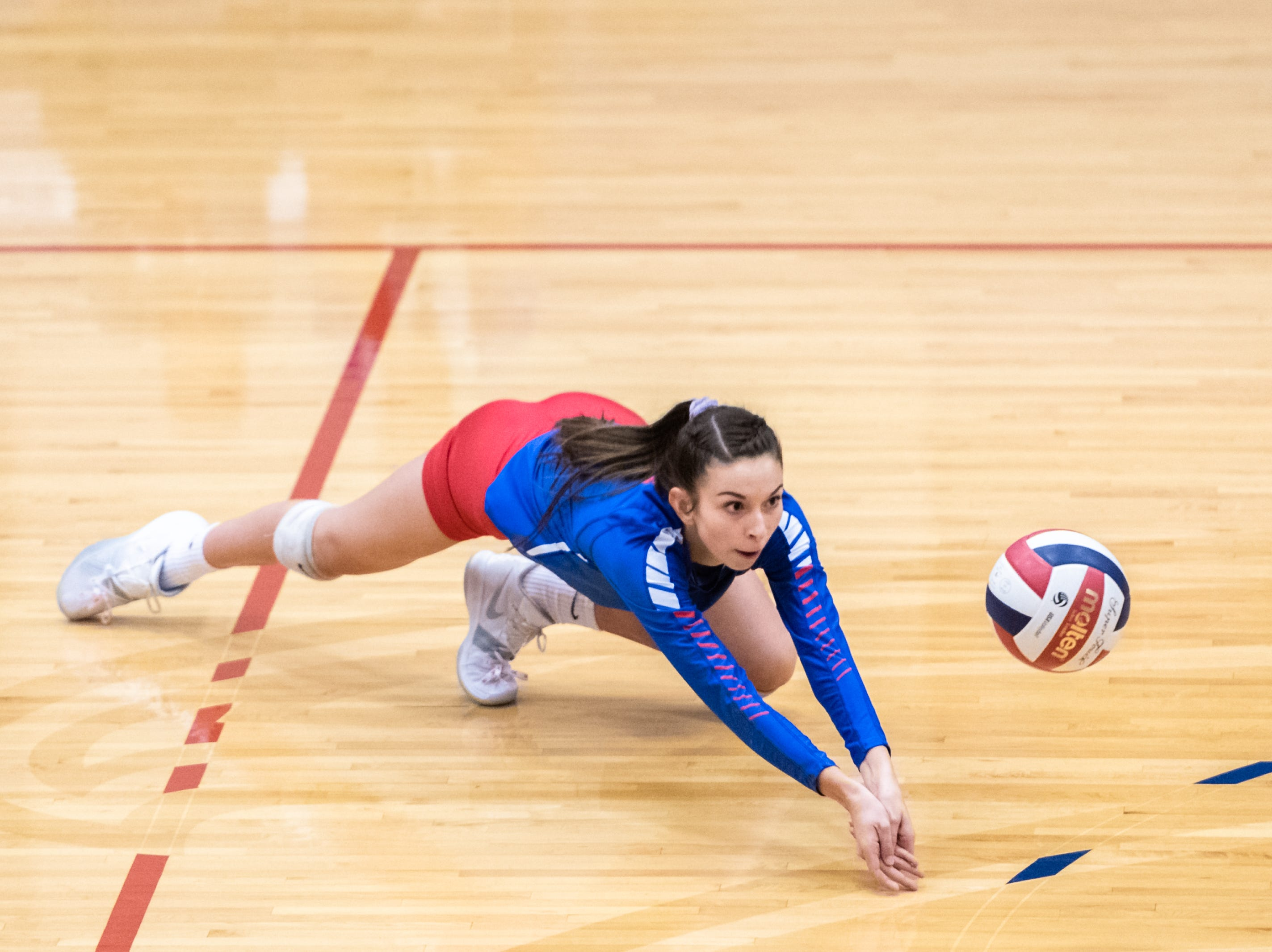 West Henderson's Katrina Kordonowy dives for a dig during their WMAC tournament championship volleyball game against Reynolds Oct. 18, 2018.