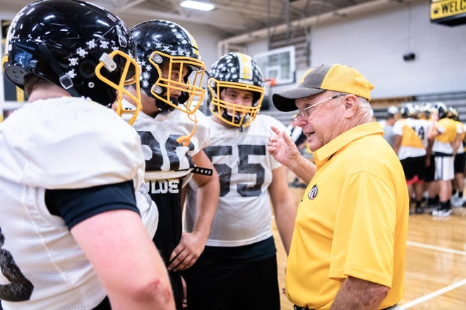 David Gentry, head coach of the Murphy high school football team, talks to some of his players during practice Oct. 16, 2018.