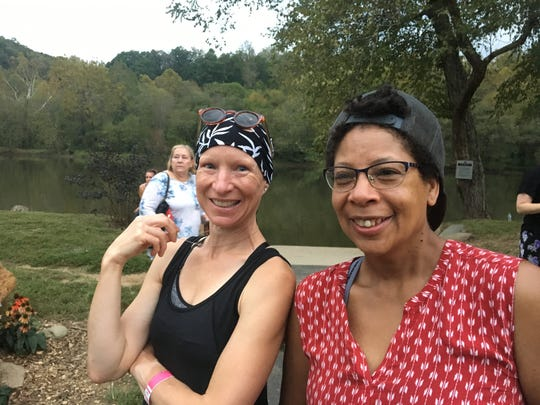Uta Brandstatter, left, and Barbara Collette, who live in Woodfin, are excited to have a greenway where they can run from their home all the way into Asheville.