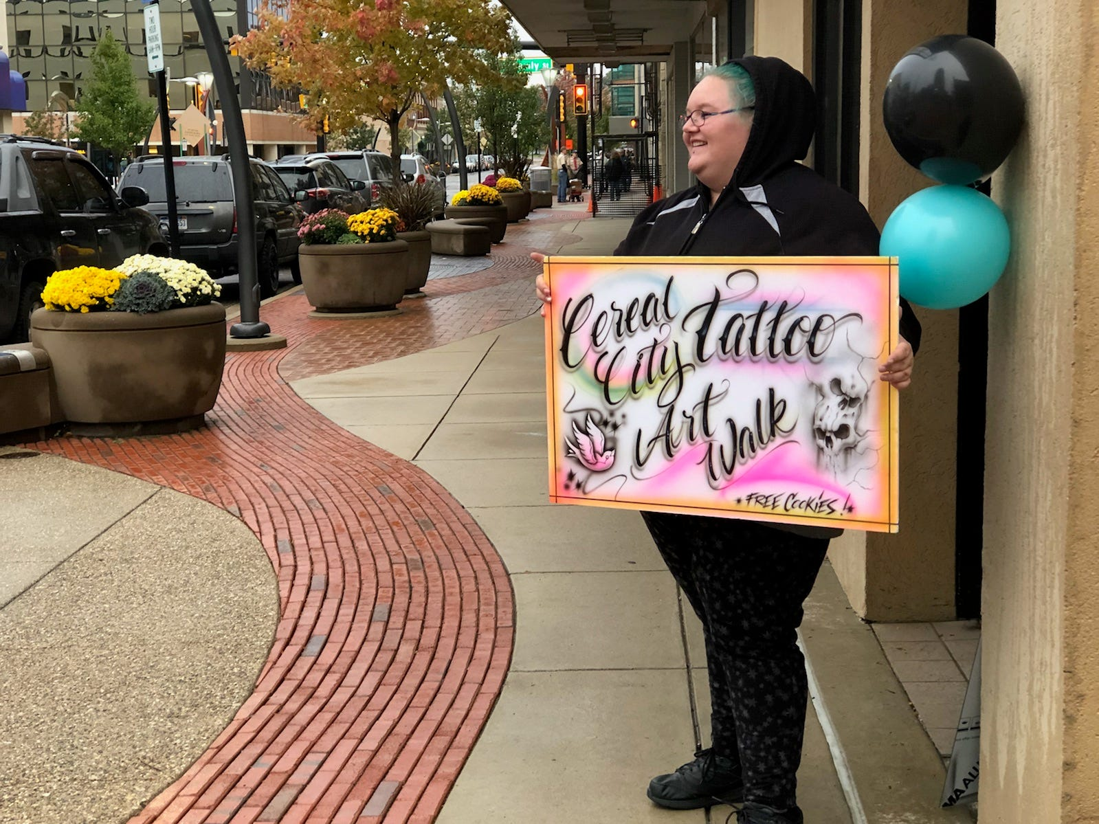 Mindi Koole of Cereal City Tattoo worked to lure people in to see art and eat cookies during Fall into the Arts.