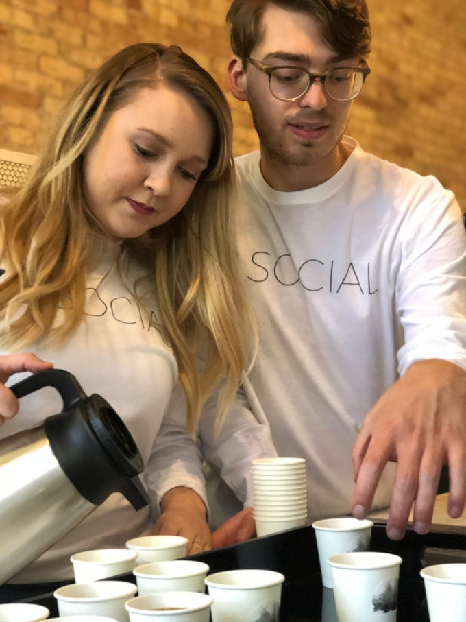 Downtown's newest coffee shop, 32 Social, was offering samples during Fall into the Arts. Jake Minear, right, with Shelby Wolverton said they look to open in the next two weeks.