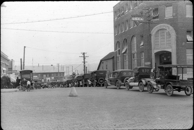 Traffic at the Bremerton ferry dock in the early 1920s is congested in spite of the posted 12 mph speed limit.  The cobblestone roadway won't be paved-over for many years. The YMCA building at right, which offered rooms for rent as well as recreation, remained as seen here until the 1970s when  it was replaced by the current YMCA in East Bremerton. To see more photos from the Kitsap County Historical Society Museum archives, visit facebook.com/kitsaphistory, kitsapmuseum.org, or stop by the museum at 280 Fourth St. in Bremerton. Call 360-479-6226 for information