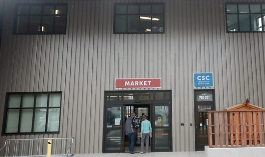 People enter the Market area at North Kitsap Fishline on Friday, October 19, 2018.