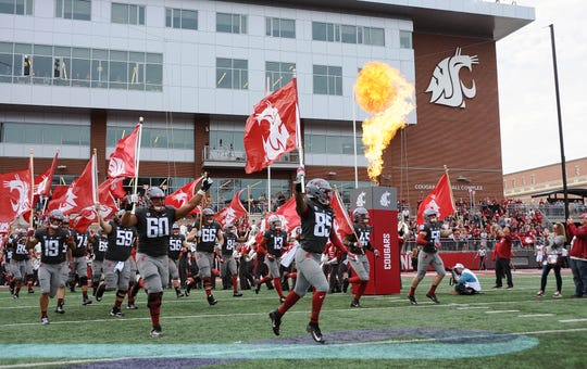 The Washington State Cougars take the field before a game last month against Utah. WSU hosts Oregon on Saturday in a game that will be spotlighted on ESPN's College GameDay.