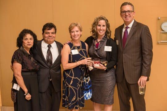 Rashmi Shah, Mike Shah, Paula Just, Connie Bradley and Steven Johnson at a BIMDA reception in 2015.