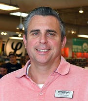 Keith Bourkney, executive director of employU, poses for a photo at Lucky's Market in West Melbourne, where they have helped get jobs for several people.