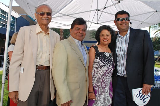 "Dr. Kantilal Bhalani, Mike Shah, Rashmi Shah and Summit Shah at the ""Build Your Future --  A Celebration of Scholarship"" fundraiser hosted by the Eastern Florida State College in 2015."