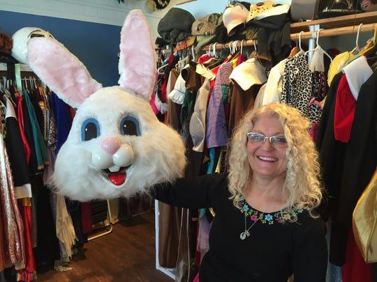 Laurie Browne holds an Easter Bunny head in her Triple Loop Costume Shop in Essex Junction.