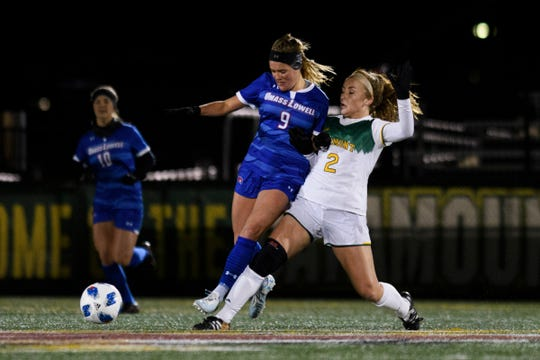 Vermont's Angie Salvi (2) battles for the ball with UMass' Veronica Morrier (9) during the women's soccer game between the UMass Lowell Riverhawks and the Vermont Catamounts at Virtue Field on Thursday night October 18, 2018 in Burlington.